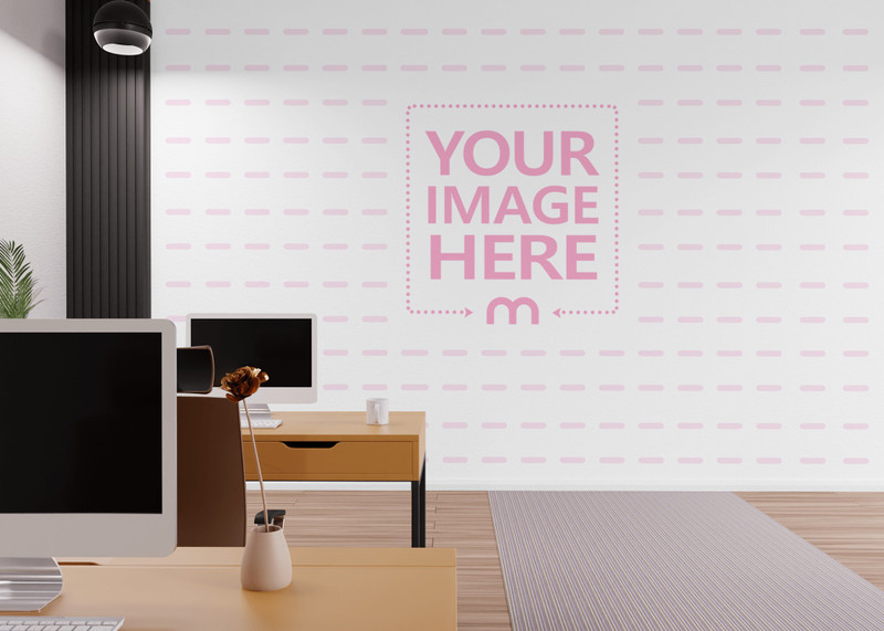 Mockup of a Wall Print Art Slightly Covered By Table and Screen