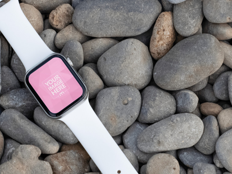 Tilted Smartwatch Mockup On top of the Stones as the Flooring