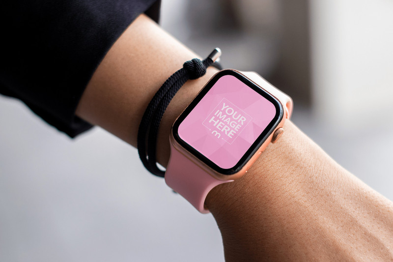 Mockup of a Smartwatch Featuring a Woman Showing it off