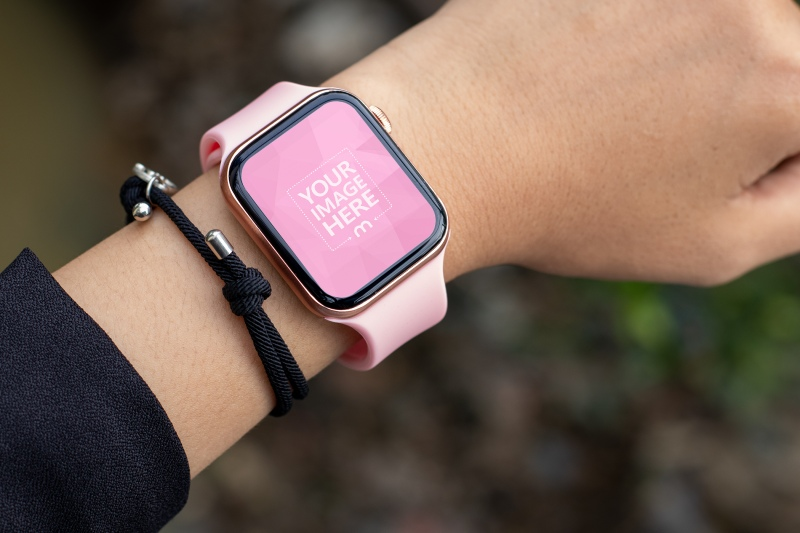 Pink Smartwatch Mockup with the Ground as the Out of Focus Background