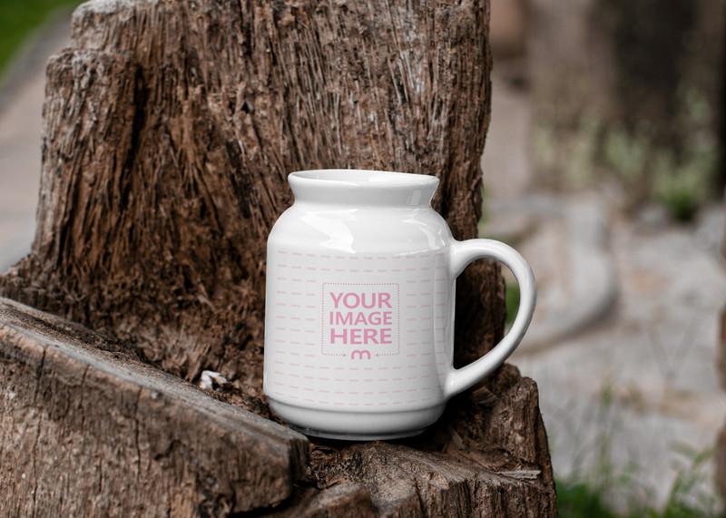 Milk Mug Mockup Showcased on top of a Tree Stump