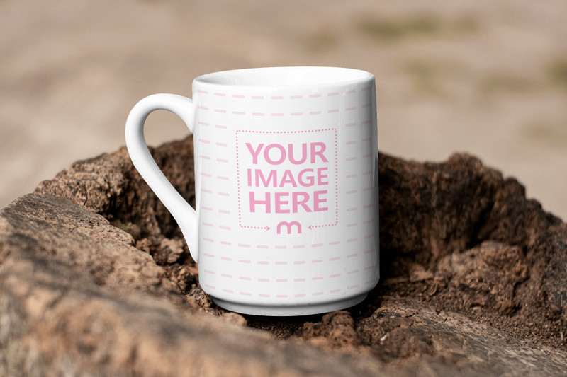 Mockup of a Coffee Mug Placed On Top of an  Old Tree