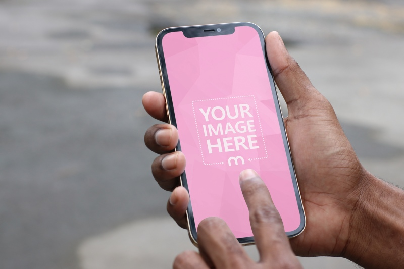 Mockup of an iPhone With Black Man holding it While Swiping