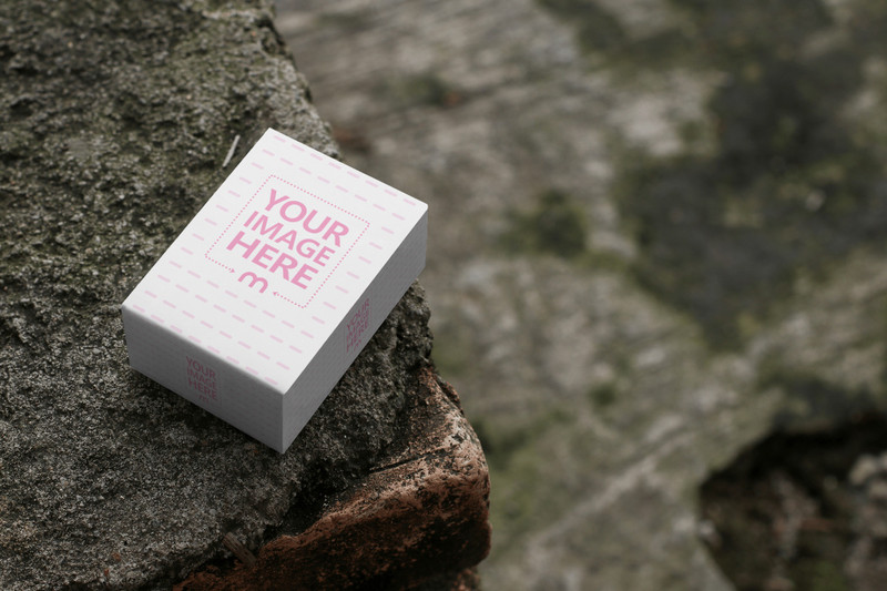 Mockup of a Small Box Placed on top of a Cement Bricks