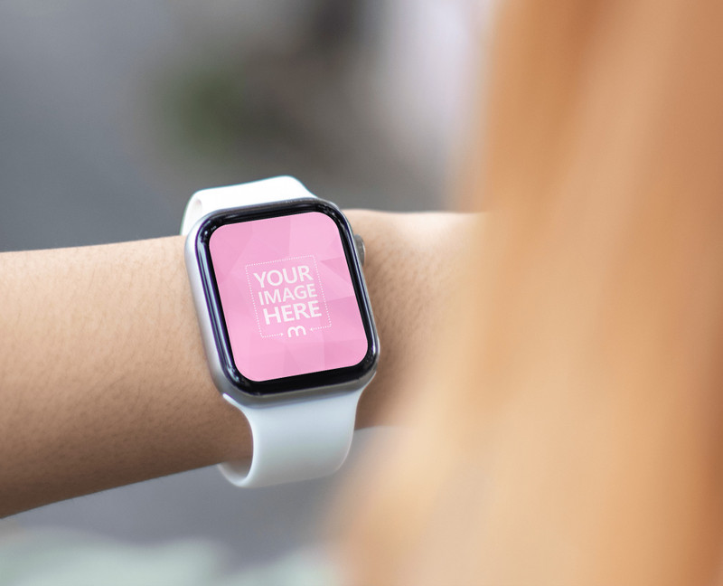 Mockup of a Smartwatch with Brown Hair Woman Watching on it