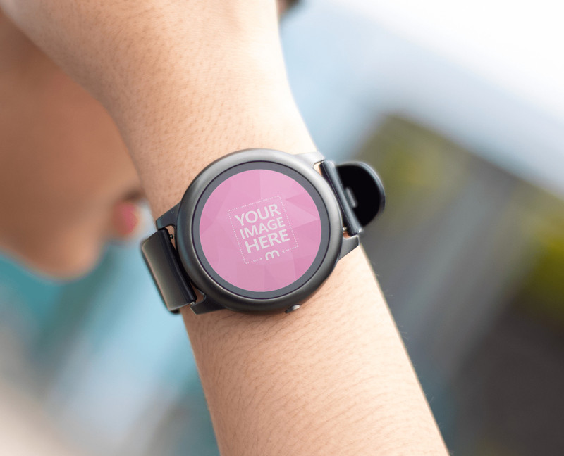 Rounded Smartwatch Mockup With a Woman Stroking Her Hair
