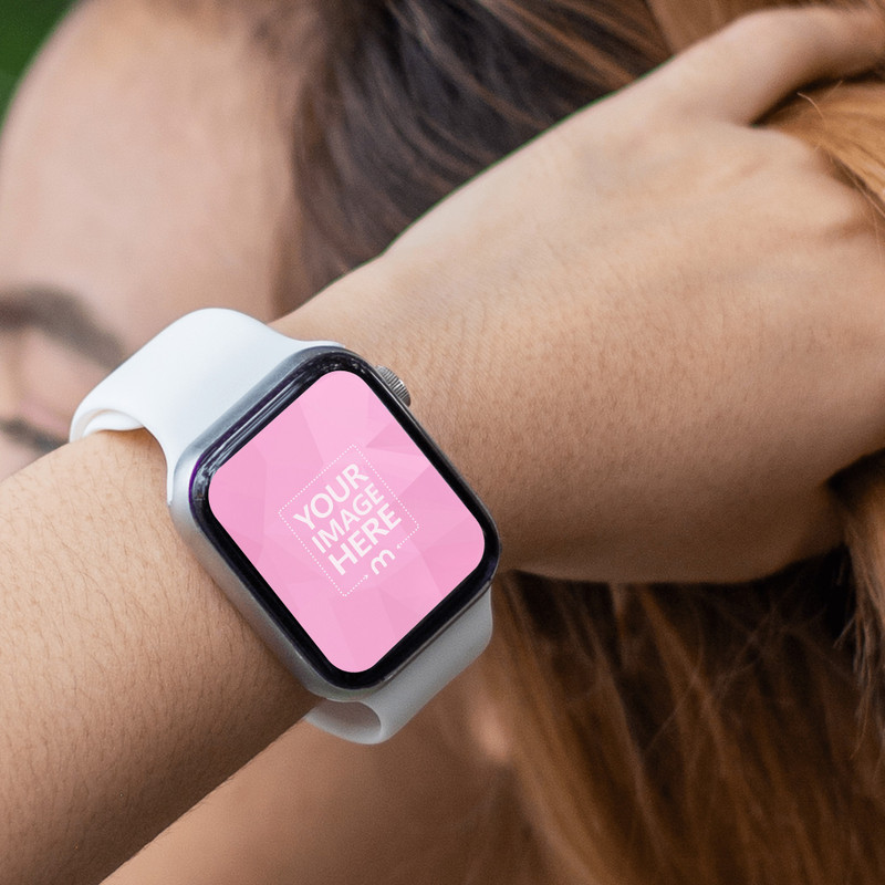 Mockup of a Rounded Smartwatch Featuring a Woman Stroking Her Brown Hair
