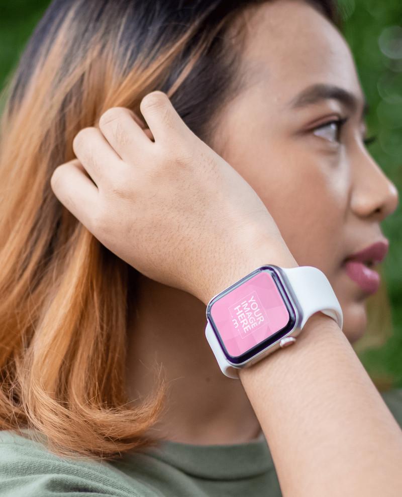 Smartwatch Mockup With a Woman Looking Sideways