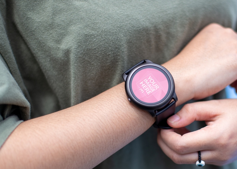 Mockup of a Rounded Smartwatch Below a Woman's Chest