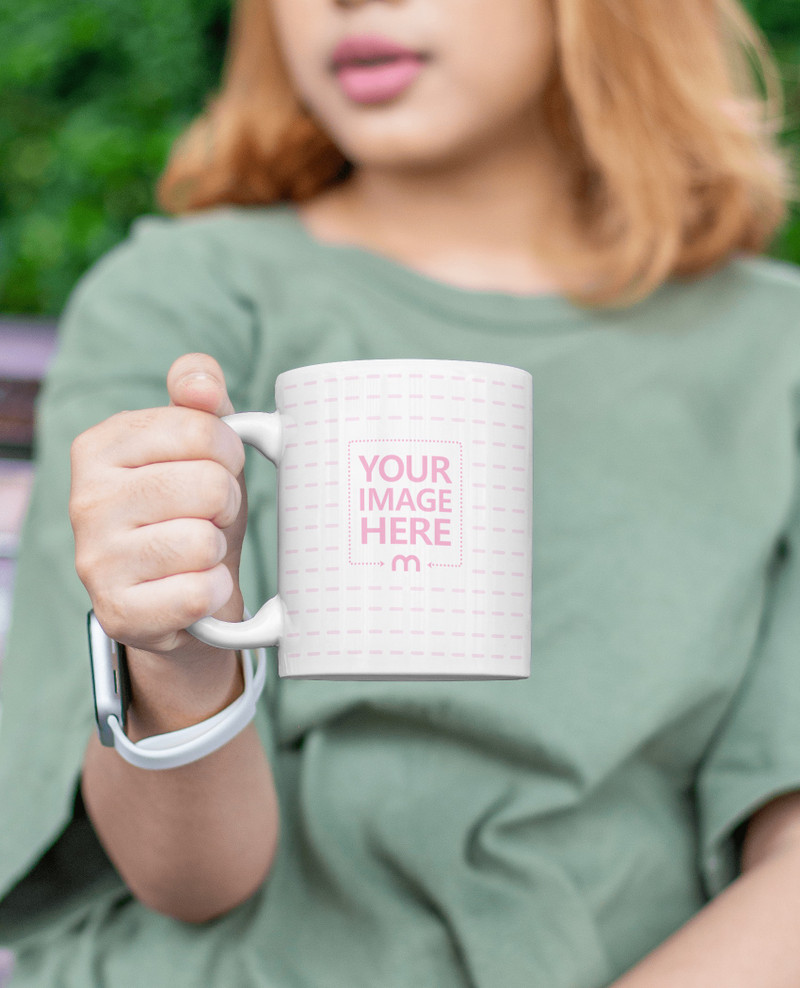 Mockup of a Mug With a Brown Hair Woman Giving it Out