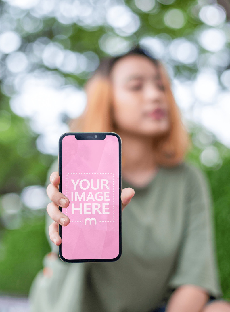 iPhone Mockup Featuring a Woman Posing While Showing off Her Phone's Screen