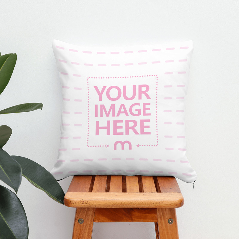 Pillow on Wooden Stool Next to Plant Mockup