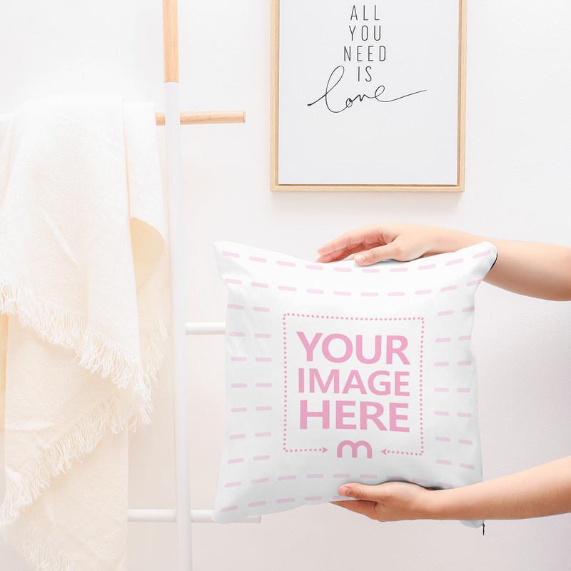 Woman Displaying Pillow Mockup