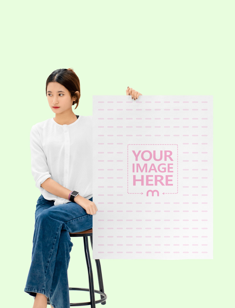 A1 Paper Mockup With a Sitting Woman Holding it on Her Side