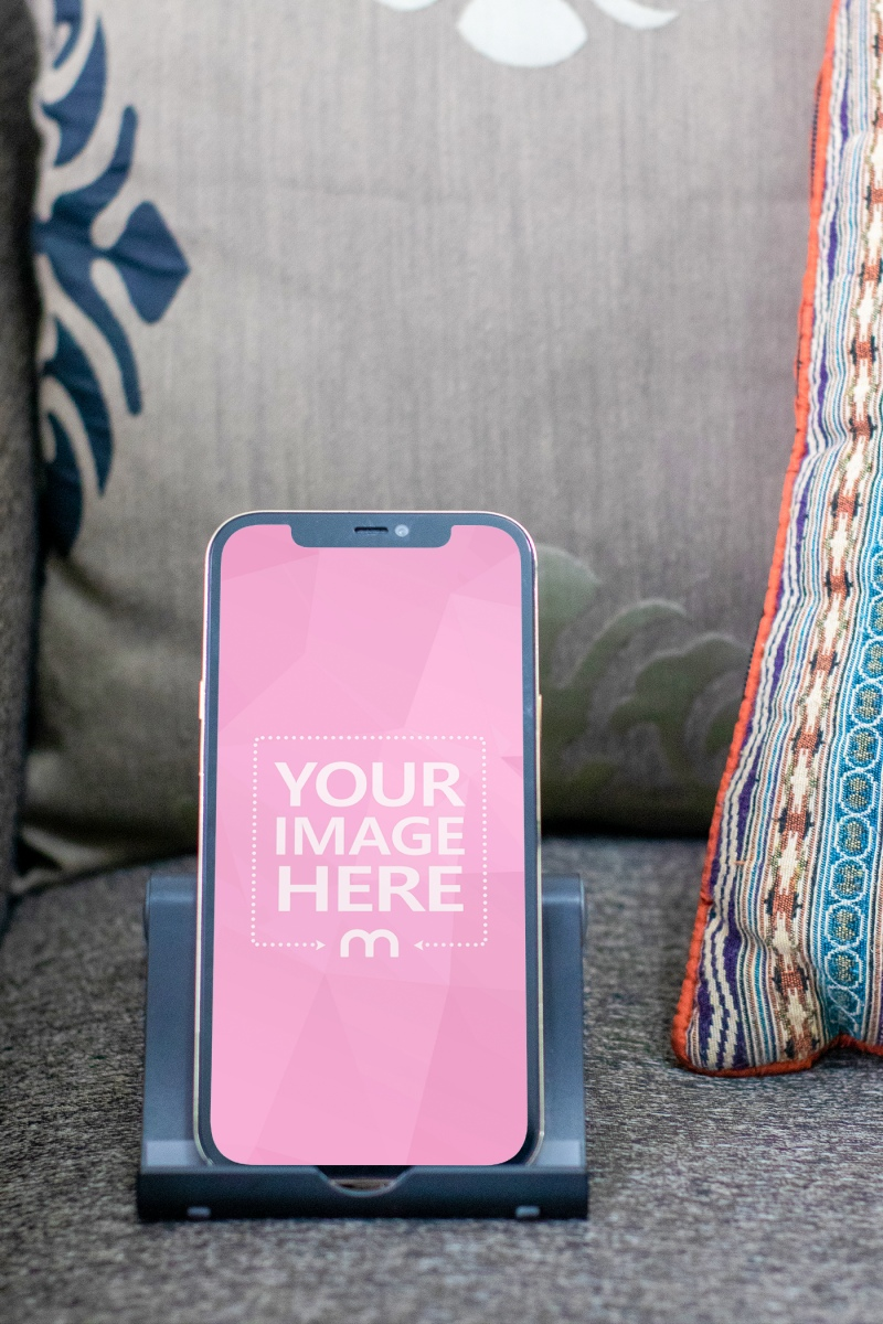 Mockup of an iPhone on top of an Armchair