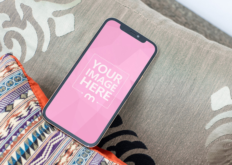 iPhone Mockup above of a Pillow With Motive on a Tilted View