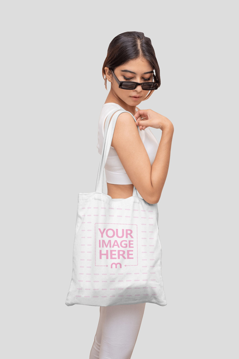 Tote Bag Mockup With a Young Woman Wearing Her Sports Bra and Legging