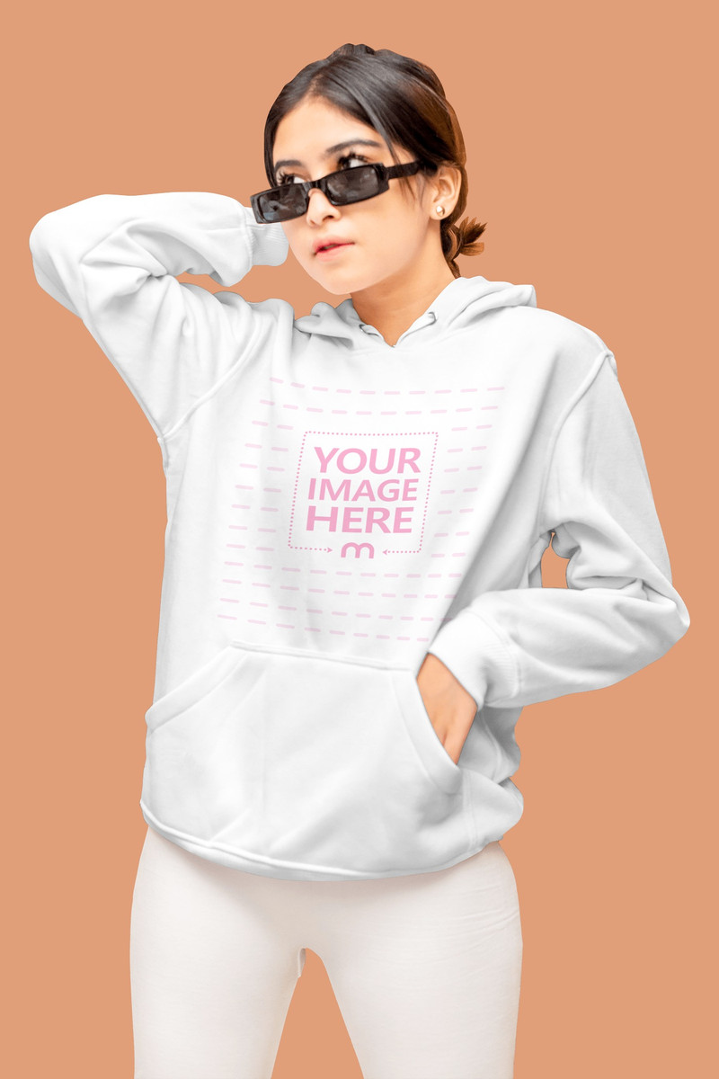 Mockup of a Hoodie With the Model Posing While looking Sideways