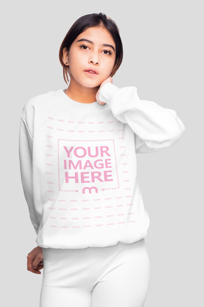 Mockup of a Sweatshirt With a Woman Posing While Facing the Camera