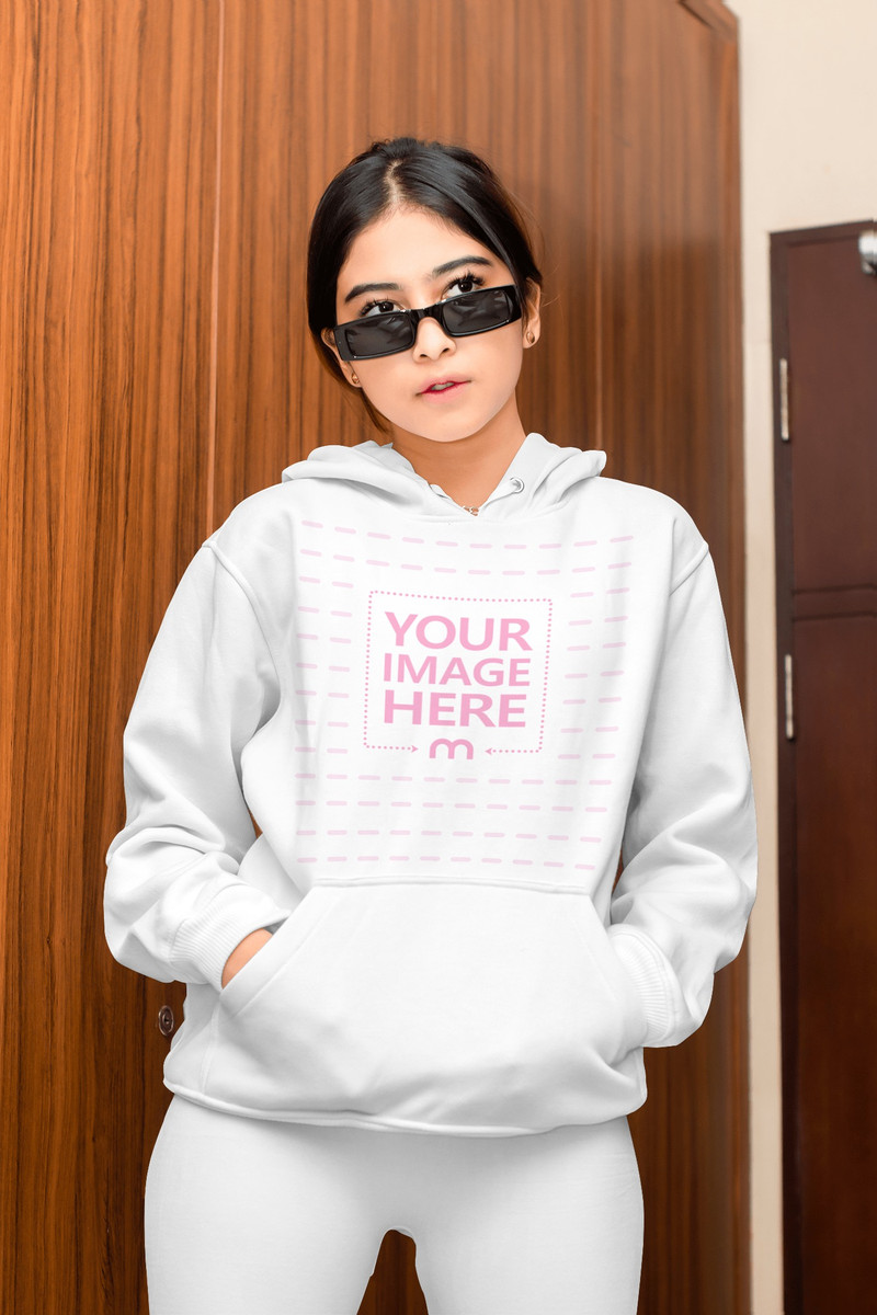 Mockup of a Hoodie With a Young Woman Posing While Looking Away