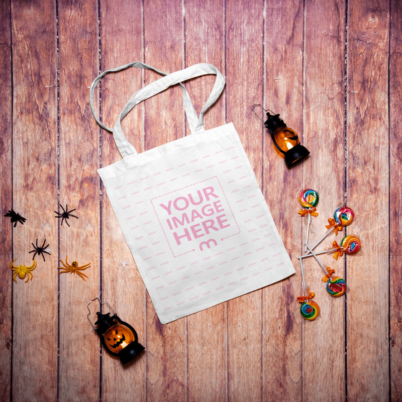 Flatlay Mockup of a Tote Bag With Some Halloween Accessories Surrounding the Bag