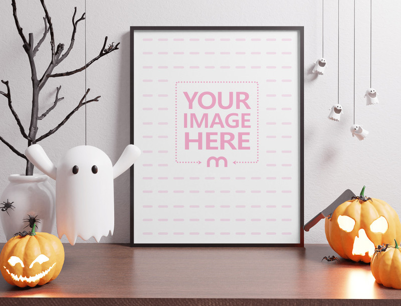 Mockup of a Canvas With a Ghost and Pumpkin as the Decorations