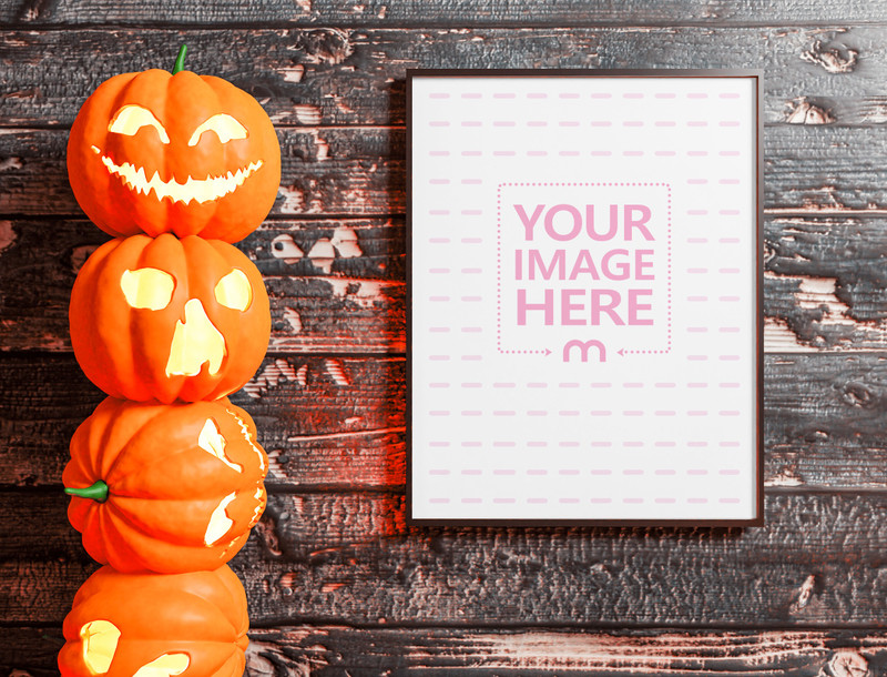 Mockup of a Canvas Beside a Stacked up Scary Pumpkins