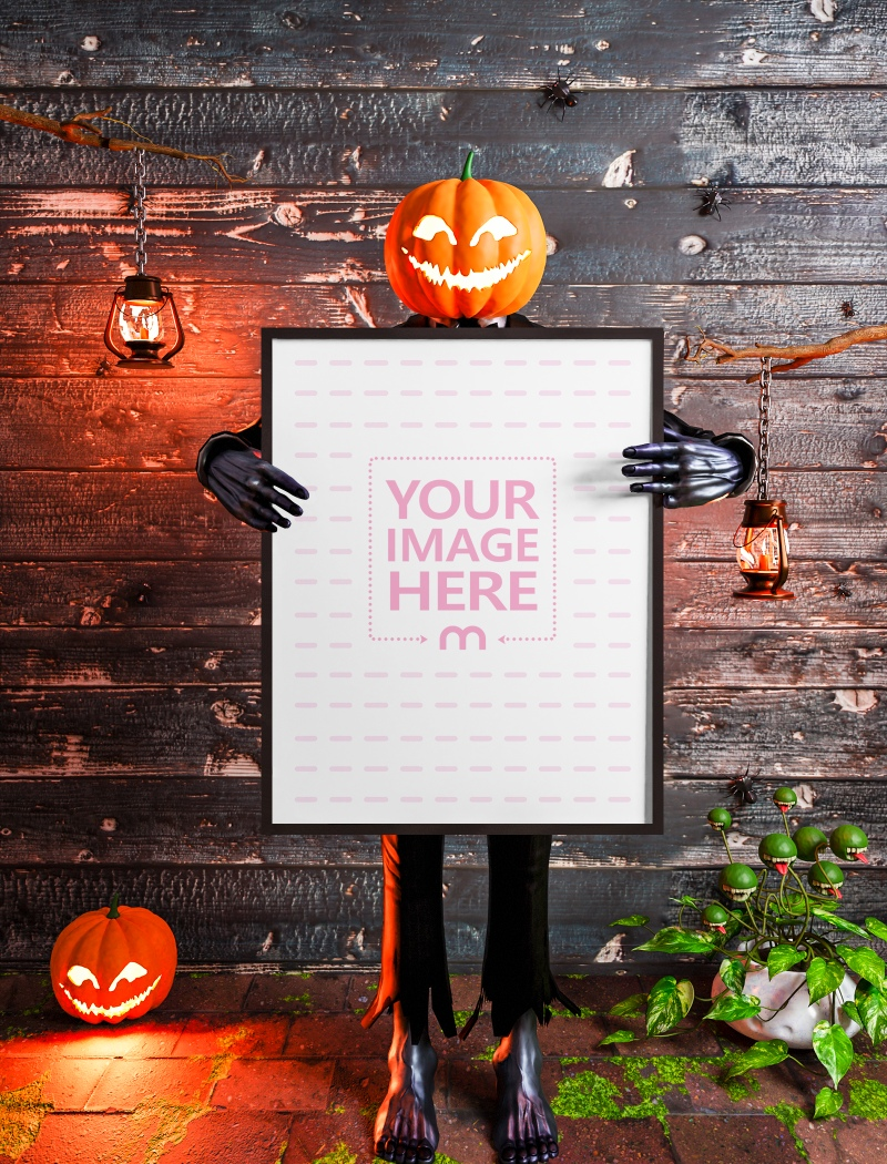 Canvas Mockup Featuring a Pumpkin Man Holding it in the Middle