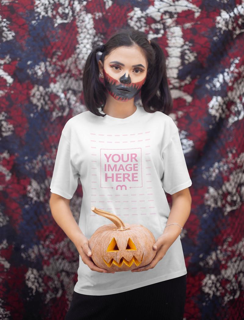 Halloween Themed Shirt Mockup With a Woman Holding a Pumpkin