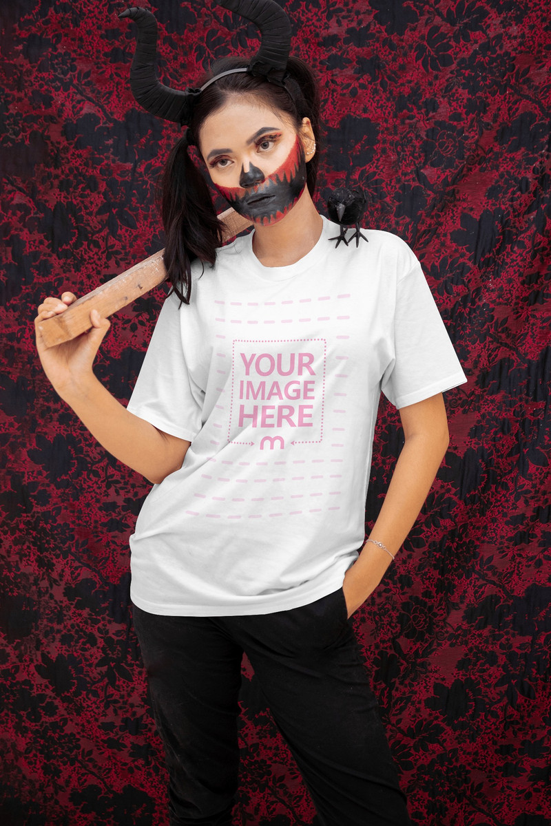 Mockup of a Shirt Featuring a Woman Holding a Wooden Stick Over Her Shoulder