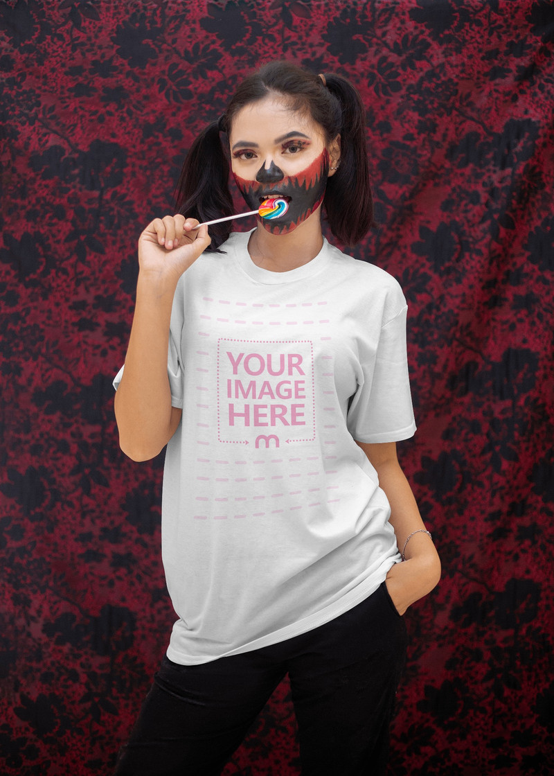 Halloween Themed Shirt Mockup Featuring a Woman Biting Her Candy