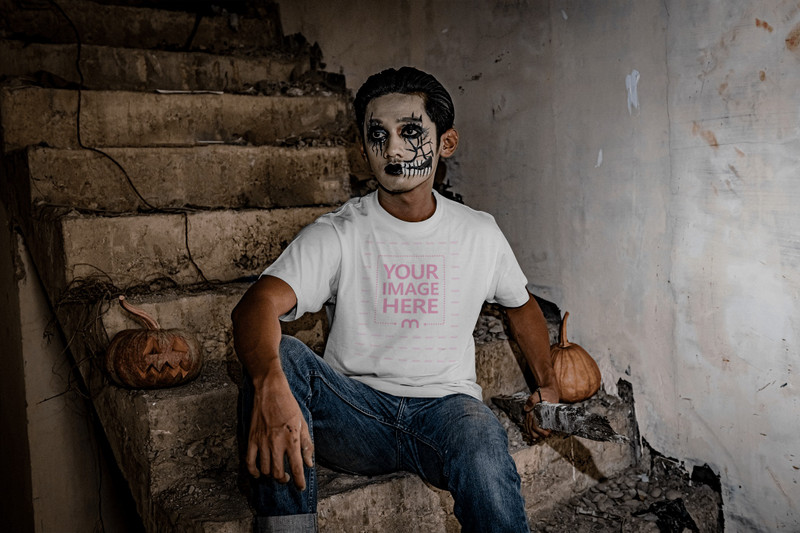 Halloween Themed Mockup Featuring a Man Sitting on a Stair at an Abandoned Building