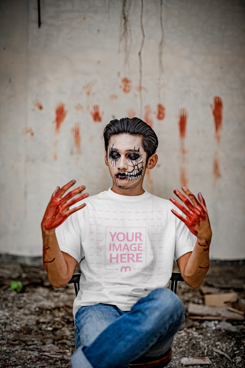 Mockup of a Shirt With a Man Looking Over His Bloody Hands