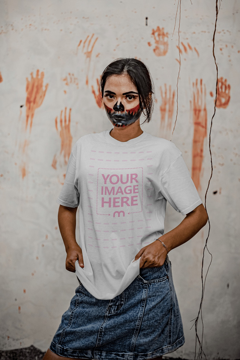 Scary Looking Shirt Mockup Featuring A Woman Looking Sharply With Bloody Hand Prints on Her Back